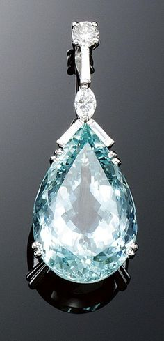 AQUAMARINE AND DIAMOND PENDANT. The facetted pear-shaped aquamarine suspended from a surmount set with brilliant-cut, marquise-shaped and baguette diamonds.