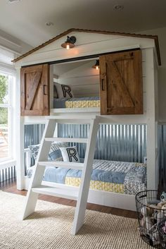 Barn wood doors are trendy, and can be used on just about anything. Love this adorable kids bed!