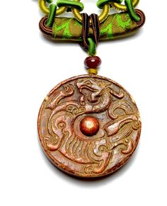 Ancient Fire Dragon Carved Jade Amulet by FortuneJadeJewelry, £109.99