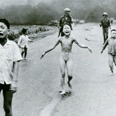 "June 8, 1972: Kim Phuc, center left, running down a road nude near Trang Bang after a South Vietnamese Air Force napalm attack. (Nick Ut /AP). Huỳnh Công Út, known professionally as Nick Ut (born 3/29/1951), is a photographer for the AP who works out of L.A. He won the 1973 Pulitzer Prize for ""The Terror of War,"" depicting children in flight from a napalm bombing. Ut became the 3rd person inducted by the Leica Hall of Fame for his contributions to photojournalism."