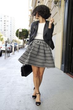 black biker jacket, white t shirt, black bag, black sandals, grid print skirt