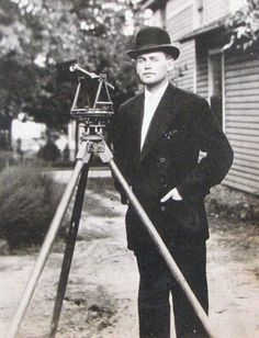 Surveyor With W. & L.E. Gurley Tranit