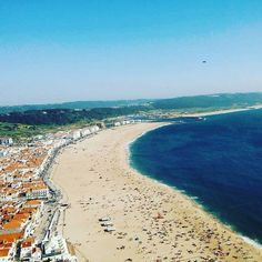 Nazaré.  This stunning view you can see from the historic part of the city called sitío which is placed on the cliff 👌 _________  Read about the best Portugal beaches in my post,  link in the bio👆 .  #sitio #nazare #Portugal #silvercoast #beach #sea #seaside #coast #coastline #seacoast #sky #nature #azuro #europe #city #town #cityphoto #photo #photography #beautiful #instaphoto #instapic #instatravel #traveling #travel #travelgram #viagem #travelgirl #world #panorama
