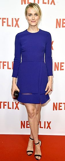 Taylor Schilling shows off her toned legs in a navy dress at the Netflix Launch Party at Le Faust in Paris