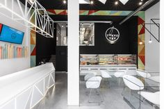 The color scheme for this #sushi bar? White rice, black nori paper, & wasabi.