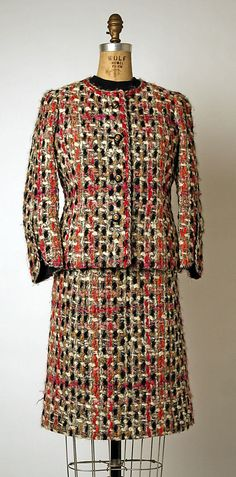 "Suit House of Chanel (French, founded 1913) Designer: Gabrielle ""Coco"" Chanel (French, Saumur 1883–1971 Paris) Date: 1965–75 Culture: French Medium: wool Dimensions: Length at CB (a): 23 in. (58.4 cm) Length (b): 21 1/2 in. (54.6 cm) Length at CB (c): 24 in. (61 cm) Credit Line: Gift of Mrs. Giorgio Uzielli, 1984"