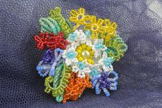 Homemade brooch woven of threads and beads by TextileJewelryStore