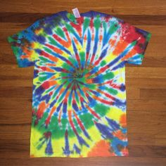 Rainbow feathered spiral! Available in our etsy shop. 15% off of everything until September 22! Code: SUMMER15 #sale #discount #etsy #etsystore #etsyfinds #tiedye #tiedyetshirt #hippie #custom #rainbow