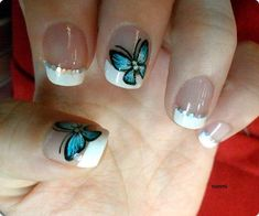 Another great design for short nails. The design starts out with a white French tip which is further bordered with multicolored beads for effect. A huge blue butterfly is them painted in strict detail as if to enthrall the attention of anyone who looks at the nails.