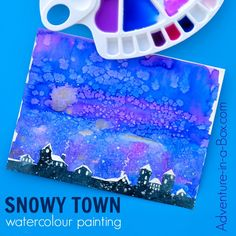 Learn how to paint a snowy town with watercolours in a simple and fun way that appeals to children. This technique introduces masking tape as a useful tool in watercolour painting.