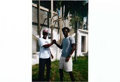 Ashley and his son Hafis in 2001 standing next to an earlier construction of The Dolphin House.