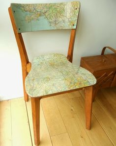 Dress up a Chair with a map, what a great idea.  Bring a nautical theme into any size room with this simple DIY project.