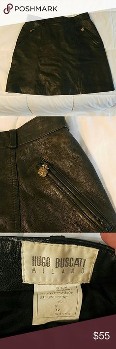 Genuine Hugo Buscati Milano leather skirt Soft buttery leather, nice detail on 2 zip pockets, no rips or tears. Tag says size, 12, but fits more like an 8/10. Back zip closure. Hugo Buscati Skirts A-Line or Full