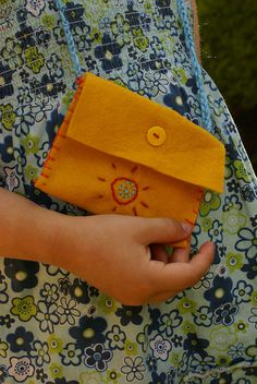 Sew Easy purse for kids to make: felt, heavy needle, yarn or embroidery floss, and button.