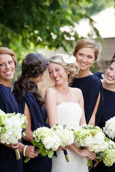 white and green wedding bouquets navy dresses