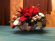 Beach Christmas arrangement...notice the shell vase and the sand dollars