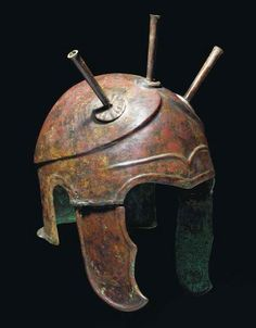 Chalcidian helmet, 4th century B.C. The crown with carinated perimeter extending into triangular contour above the brow, three plume holders attached above, contoured 'eyebrow' at centre-front, with hinged cheekpieces, 31.5 cm high incl. plume holders. Private collection, from Christie's auction