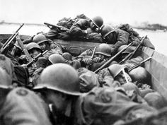 D-Day 1944 by Robert Capa (this is NOT a Capa photo: Soldiers from the US 89th Infantry Division cross the Rhine River in assault boats under German fire/Beginning on the night of 23 March 1945, Operation Plunder was the crossing of the River Rhine at Rees, Wesel, and south of the Lippe River)
