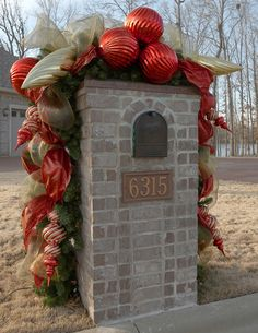 Mailbox Christmas garland - no info but lots of pictures for ideas.  I make these with work garlands, add lights and attach them to the brick mailbox frames with fishing line to keep it invisible and yet firmly attached.  You can also do it with a regular  garland