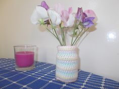 This is a little meat paste jar covered in pastel colours, just right for my sweet peas
