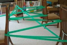 Jungle Vine gross motor activity. Great activity for jungle or rain forest theme or unit. Gets kids crawling, climbing, slithering, and scooting. Perfect for toddlers, preschool, or elementary. #homeschoolingfortoddlerslessonplans