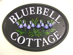 Bluebell Cottage sign with raised hand painted bluebells on this oval house name sign