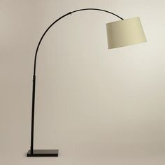 Loden Arc Floor Lamp Base - World Market. This is the cheap version of the Pottery Barn Lamp I can't afford ($500.00!!??) This one is only $109.00 :)