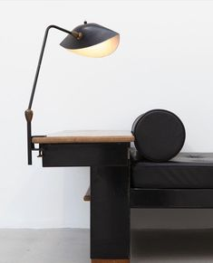 Serge Mouille desk lamp (1958) and Jean Prouvé bed, model no.102, designed for the Lycée Fabert, Metz (1936)