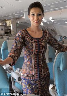 Very excited to experience Singapore Airlines,  kind and gentle crew.  Like and bought this outfit in red.