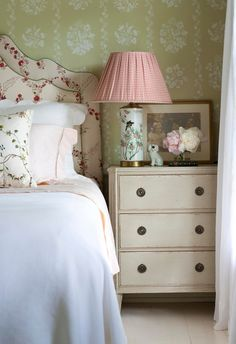 Floral wallpaper, headboard, gathered lampshade with a small pink check print - Sallie Giordano