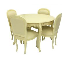A stunning Ivory carved round dining set and 4 chairs.