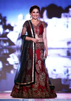 Madhuri Dixit walked the ramp in a beautiful red lehenga choli at the 'Save & Empower the Girl Child' fashion show. Source: indiatoday.in