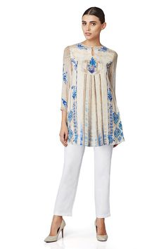 An exquisite, digital printed, long top in beige and blue with pleats at the front.INR 7,990.00