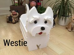 wooden garden ornament WESTIE design. made to order can be painted in any colour. if you provide a picture we can also paint in similar colours and markings to your pet name tag can be added free of charge.please tell us the name you would like. the planters have been made with