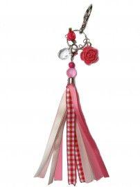 Royale tassen hanger gemaakt van linten. Verschillende bedels, roosjes en hangers.  Kleuren en materiaal kunnen afwijken van de foto. Iedere accessoire is herkenbaar aan het Dutch & Dots Bedel.