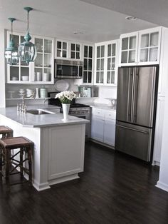 kitchen ideas-love the open cabinets and the aqua light fixtures. Would want darker counters though