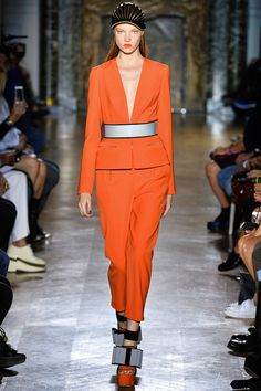 John Galliano Spring 2014 RTW. #JohnGalliano #Spring2014 #PFW neoprene. orange. acid. punch. deep V. luminescence. silver. cinched waist. bows. spring suit.