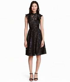 Black/glittery. Knee-length dress in jacquard-weave chiffon with glittery threads. Narrow-cut at top, stand-up collar, double ruffles at front and back, and