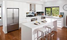 Masterton | Jim wouldn't have it any other way. Crisp white modern kitchen with servery window