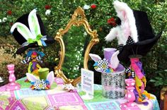 Alice in Wonderland party. Mad Hatter vanity display.  The rabbit ears sticking out of the hats are especially charming