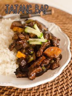 Jajang Bap {Korean/Chinese Black Rice} 2 tablespoon oil ½ yellow onion, diced 1 lb steak meat, cut small 1 zucchini, sliced and diced ½ cup green peas 4 tablespoons jajang paste 1 cup water 1 tablespoon corn starch 2 tablespoons water ½ cucumber, peeled and cut in matchsticks Rice
