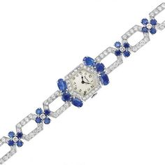 Platinum, Diamond and Sapphire Wristwatch, Cartier for Sale at Auction on Wed, 12/12/2012 - 07:00  - Important Estate Jewelry | Doyle Auction House