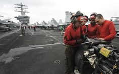 PACIFIC OCEAN (May 10, 2013) Marines aboard the aircraft carrier USS Nimitz (CVN 68) clean the M61A1 21mm machine gun of an F/A-18C Hornet assigned to the Death Rattlers of Marine Fighter Attack Squadron (VMFA) 323 on the flight deck. Nimitz and Carrier Air Wing 11 are currently underway on a scheduled Western Pacific deployment. (U.S. Navy Photo by Mass Communication Specialist Seaman Kole E. Carpenter/Released)
