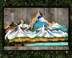 "This piece is made on reclaimed wood with a mountain range cutout. Paint d within is also a beautiful mountain range of colors to make the scene pop. Measures at 20""x30"" or 12""x18"". This piece is made to order. Each made to order piece will take 1-2 weeks prior to shipping"