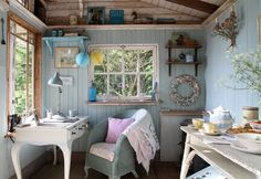 Although not technically a tiny home, great inspiration for one!  http://thetinylife.com/cozy-beach-cabin/