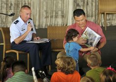 130428-N-QG393-048 PEARL HARBOR (April 28,2013) Col Dann Carlson, Deputy Commander of Joint Base Pearl Harbor-Hickam, and Todd Apo of the Disney Aulani Resort read to children during the Books on Bases event held at the Hickam Officers Club. Blue Star Families in conjuction with the Walt Disney Company donated more than 1000 books through Blue Star Familes, a nonprofit network of military familes dedicated to supporting, connecting, and empowering military familes. (Photo by MC2 Tiarra…