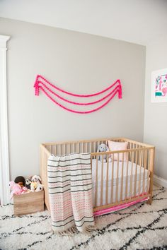 "At long last, I am so excited to share our baby girl's nursery tour with you! I really wanted to create a special space for her, one that was modern but still super cozy. It was important to me that it feel playful and whimsical without screaming ""baby"" in the traditional sense. It took several months to come together and just a few short days before she was born, I finally finished getting the room painted, furnished and styled. I'll list and link as ..."