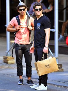 Two of the Jonas bros raided SoHo's high-end shops for some retail therapy in matching wayfarers & preppy tennis shoes