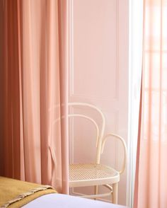 pale pink curtains and cream bentwood chair. / sfgirlbybay