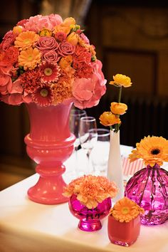 Wedding Vases: love the bold colors and shapes...even the small vases make a statement.... Use these with Neutral colored flowers! :)